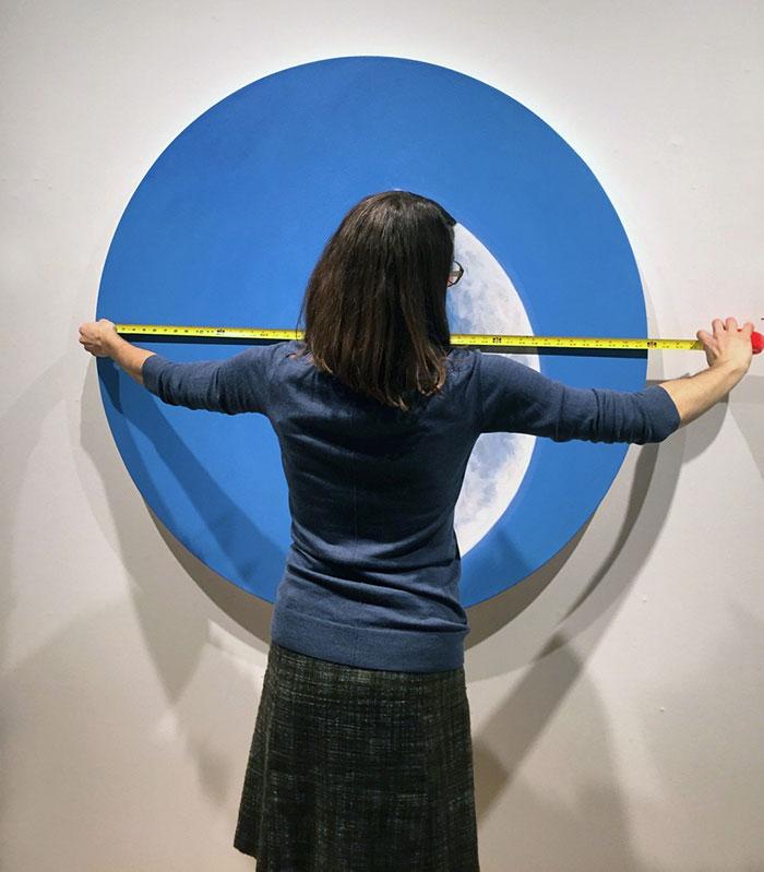 Woman measuring an art piece
