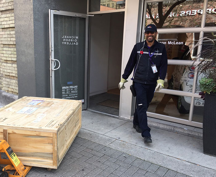 Delivery man moving crate